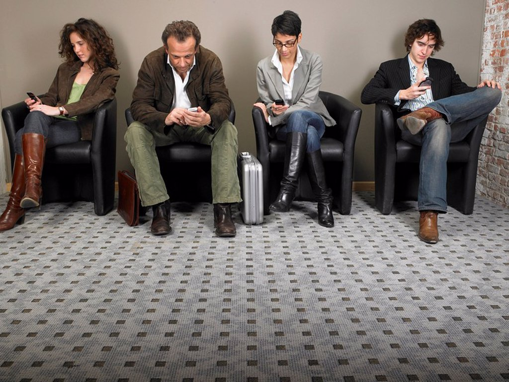 Stock Photo: 1773R-176862 Two businesswomen and two businessmen sitting in waiting room