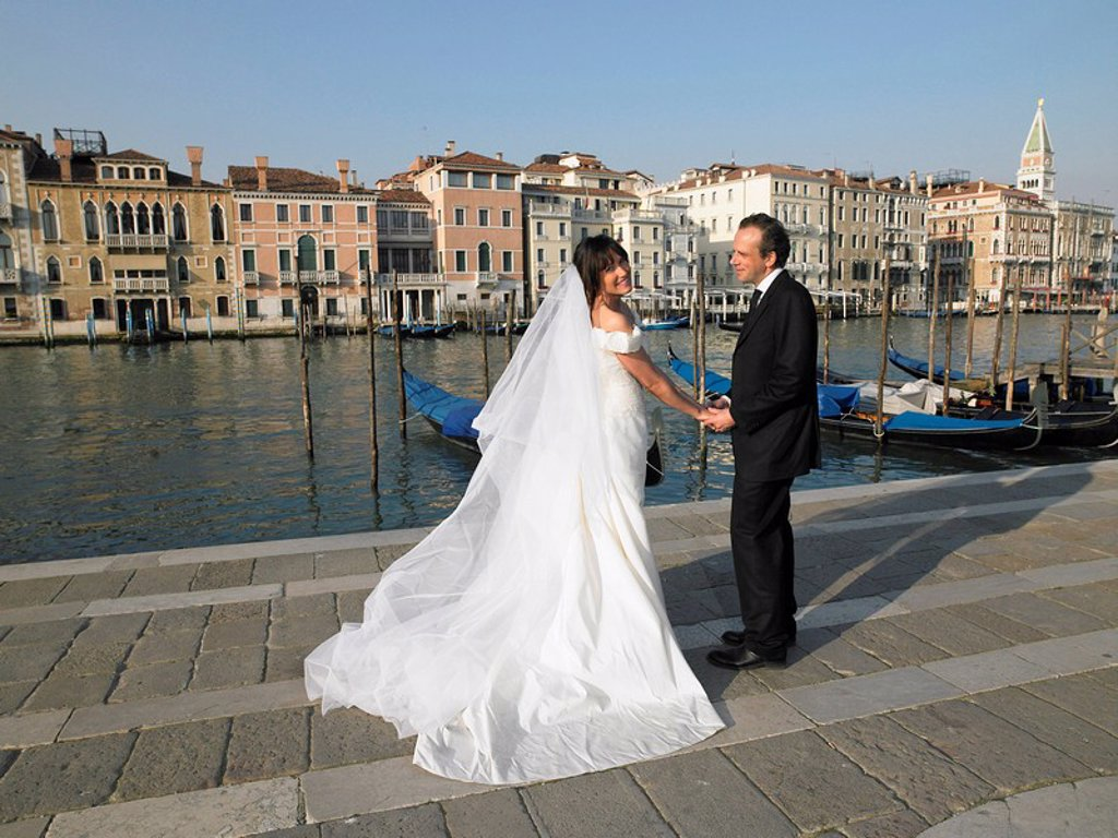 Stock Photo: 1773R-176975 Bride and groom holding hands Grand Canal, Venice, Italy