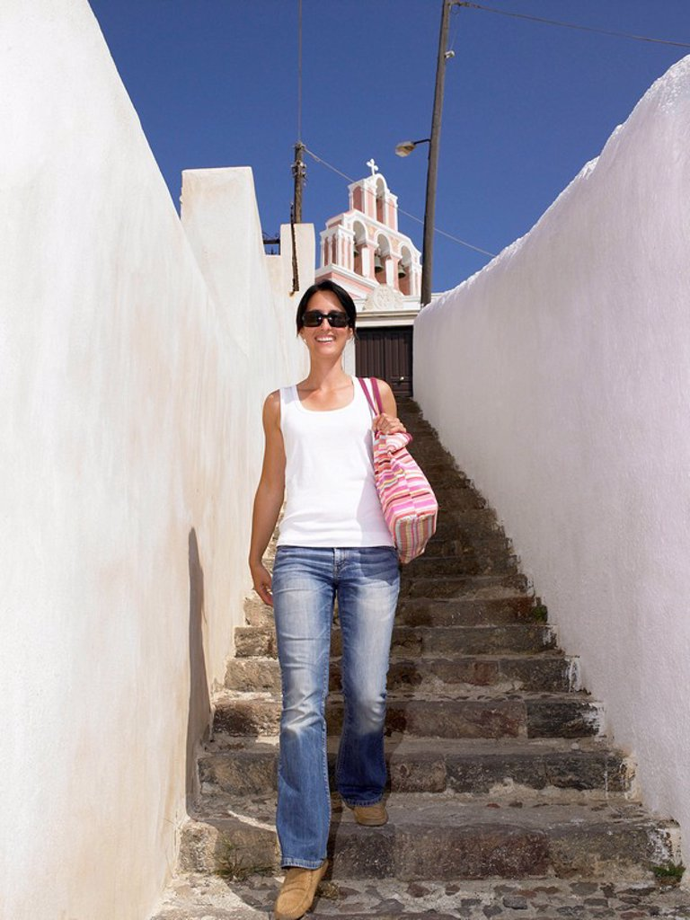 Stock Photo: 1773R-177831 Woman climbing down the stairs