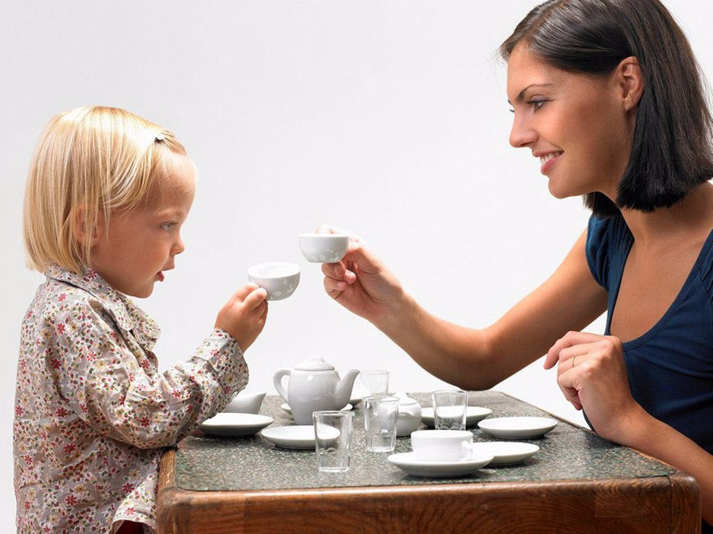 Stock Photo: 1773R-177928 Daughter and mother having tea