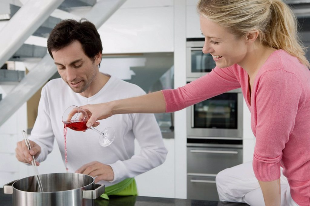 Stock Photo: 1773R-180306 Portrait of a couple cooking