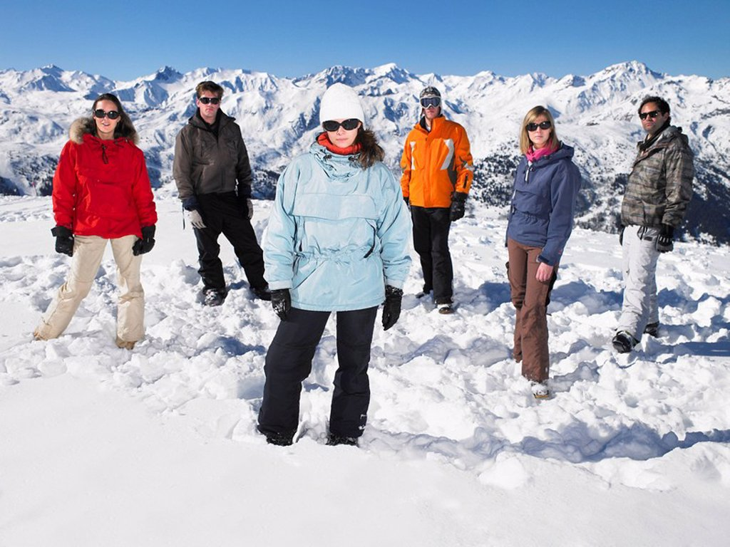 Group standing in snow : Stock Photo