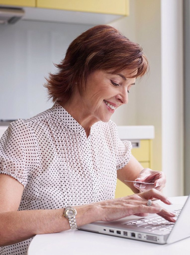 Senior woman purchasing on internet : Stock Photo