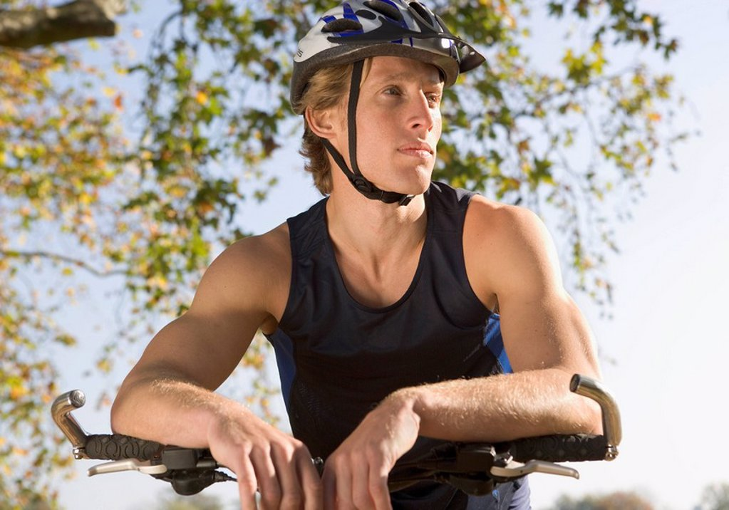 Portrait of cyclist with helmet and bike : Stock Photo