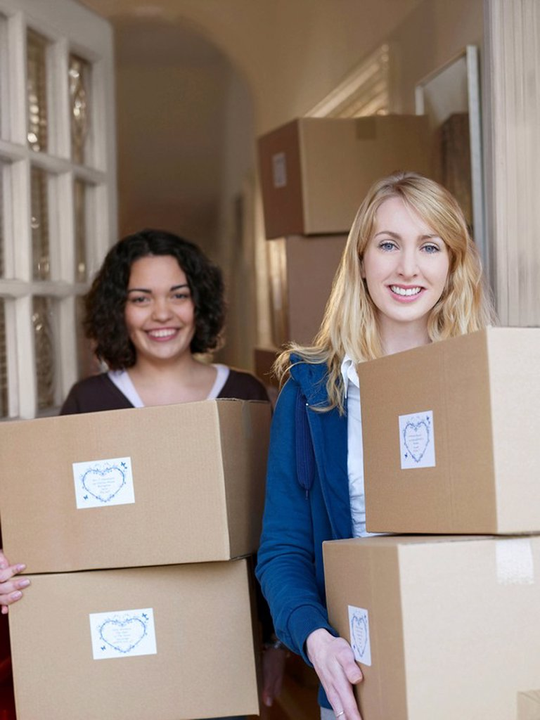 Stock Photo: 1773R-182182 Women with boxes of goods in doorway