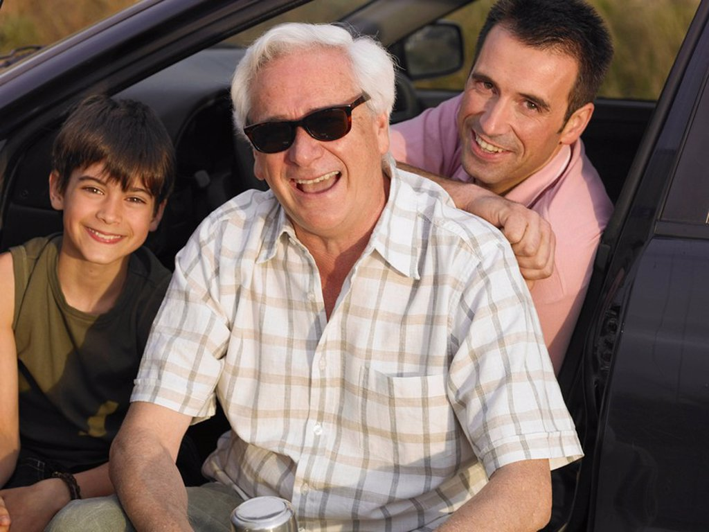 Stock Photo: 1773R-182218 Boy 8-10 sitting with father and grandfather in parked car, smiling, portrait