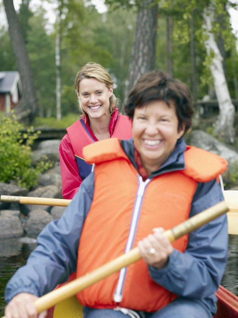 Stock Photo: 1773R-182558 Two women in a boat smiling