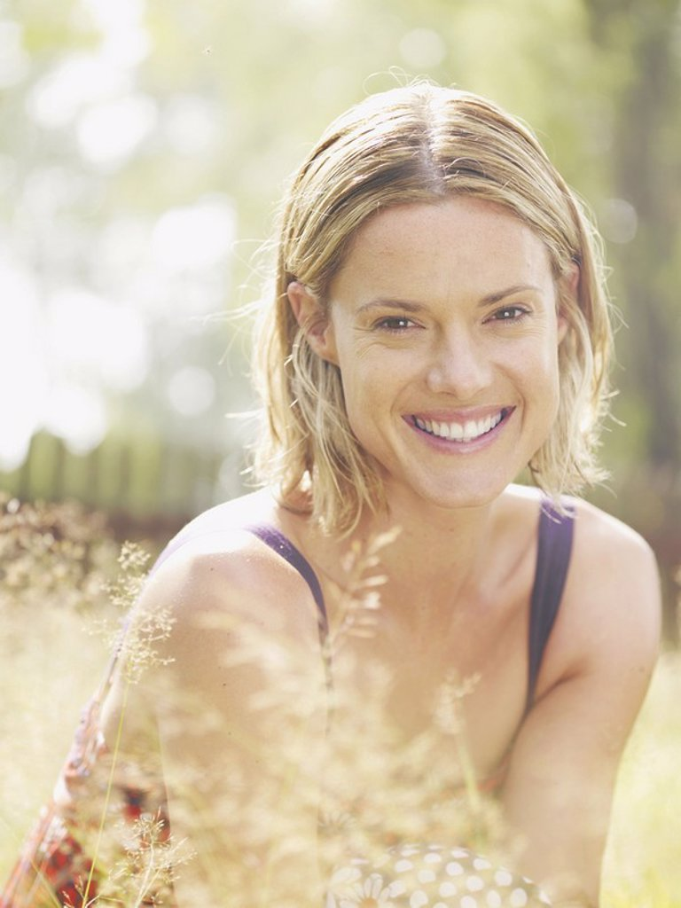 Woman outdoors smiling : Stock Photo