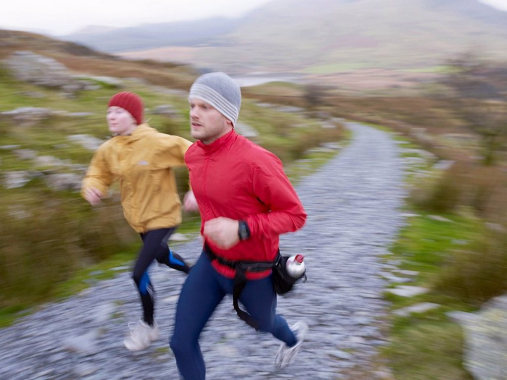 Stock Photo: 1773R-182623 Couple running