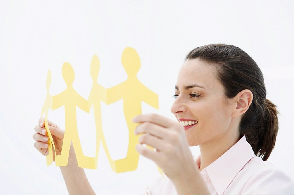 Smiling woman holds paper chain : Stock Photo