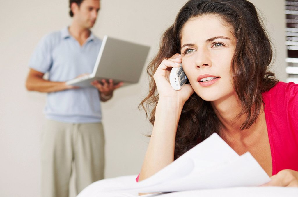 Stock Photo: 1773R-183266 Woman on phone with bills and male