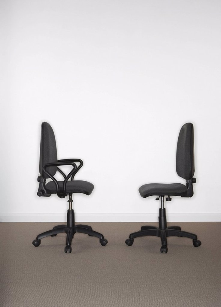 Two office chairs facing each other : Stock Photo