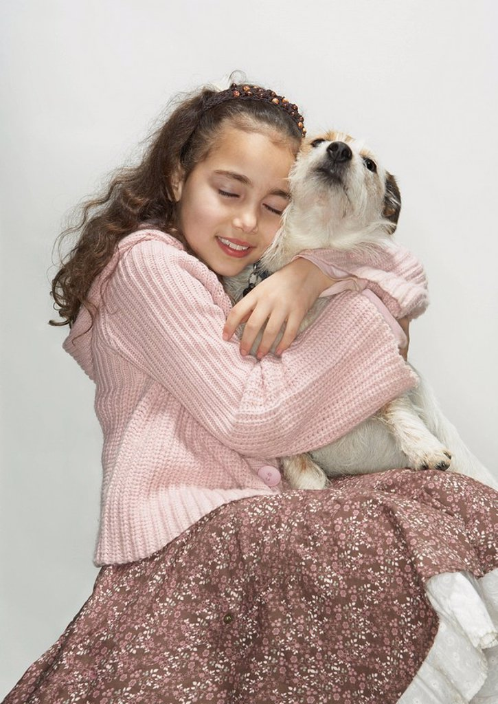 Portrait of girl and terrier : Stock Photo