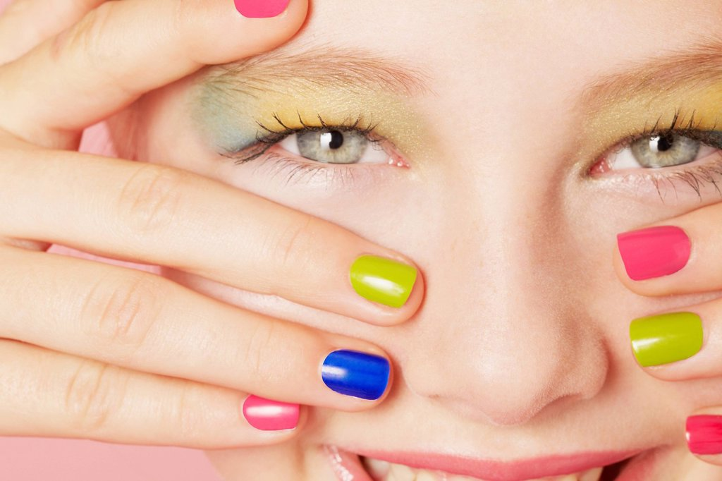 Stock Photo: 1773R-185175 Smiling girl wearing colorful makeup