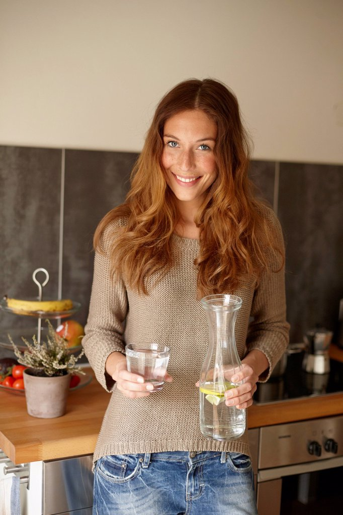 Stock Photo: 1773R-185348 Smiling woman having glass of water