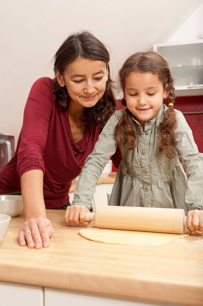 Stock Photo: 1773R-185381 Mother and daughter baking together