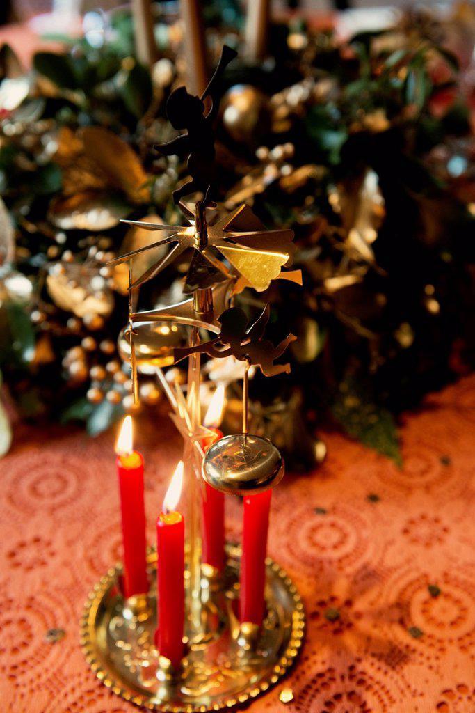 Stock Photo: 1773R-186400 Candles burning on Christmas decoration