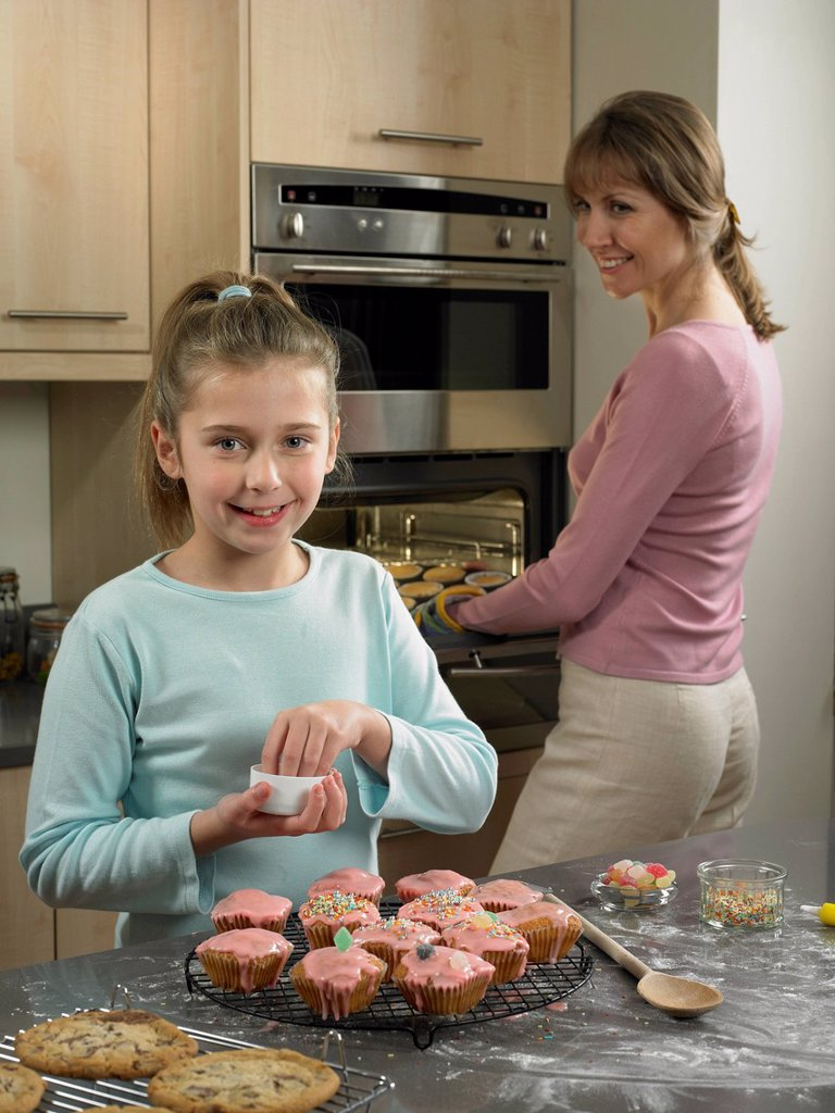 Stock Photo: 1773R-187732 Mother and daughter baking together