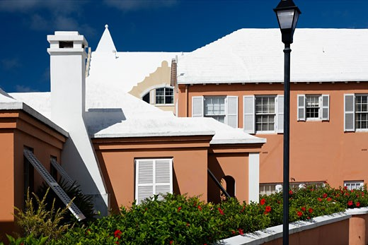 Bermuda Architecture, Buildings with Pastel Colored Walls and White Lemestone Roofs; Hamilton, Bermuda : Stock Photo