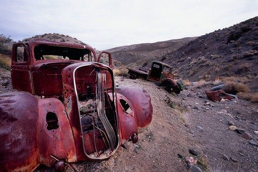 Old truck wrecks in a ravine, Death Valley, Death Valley National Park, California, USA : Stock Photo