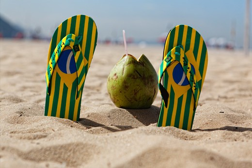 Brazil, Rio de Janeiro, Copacabana Beach, Flip-Flops and Coconut in sand : Stock Photo