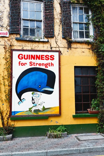 Stock Photo: 1774-708 Ireland, County Cork, Kinsale, Old Guiness Sign on House