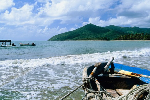 Puerto Rico, Maunabo, Old fishing boat in bay : Stock Photo