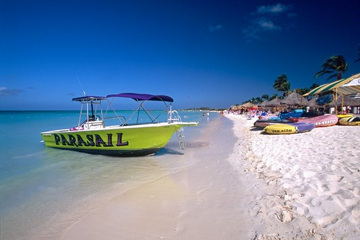 Dutch Antilles, Aruba, Eagle Beach View with Boat and Palapas : Stock Photo