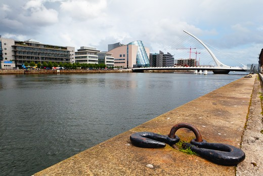 Republic of Ireland, Dublin, Low Angle View of Quay on Liffey River with Samuel Beckett Bridge : Stock Photo
