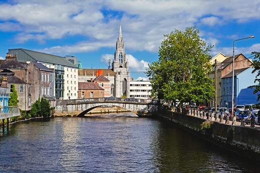 Republic of Ireland, County Cork, Cork City, View of River Lee with Holy Trinity Church in Background : Stock Photo