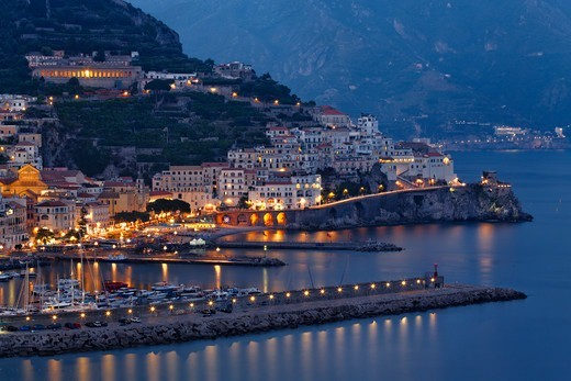 Italy, Campania, View of Amalfi Town with harbor at night : Stock Photo