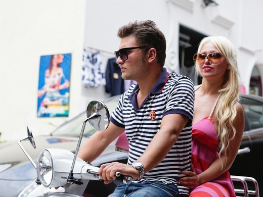 Stock Photo: 1774-839 Italy, Campania, Positano, Young couple on scooter