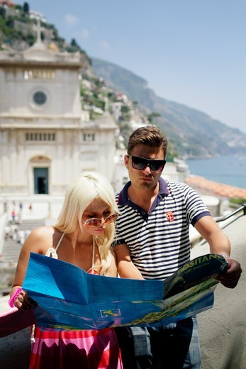 Stock Photo: 1774-840 Italy, Campania, Positano, Young couple looking at map in old town