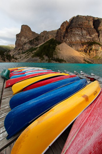Stock Photo: 1774R-389 Canoes on a dock for rent, Moraine Lake, Banff National Park, Alberta, Canada