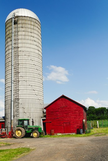 Stock Photo: 1774R-649 USA, New Jersey, Hunterdon County, Tractor parked in front of silo and barn at farm