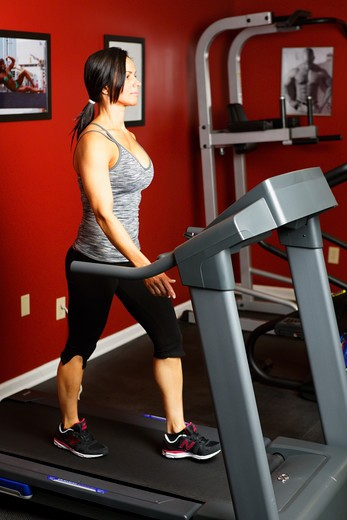 Stock Photo: 1774R-757 USA, New Jersey, Fit Mid Adult Woman Exercising on Treadmill