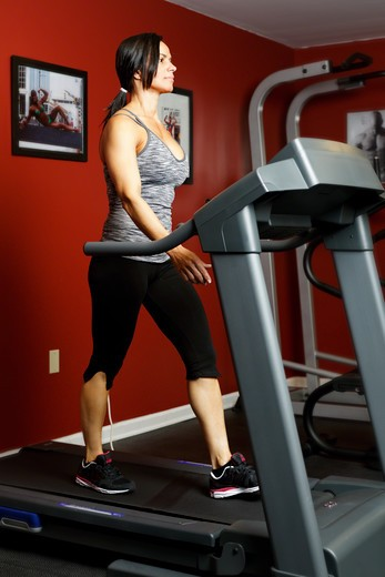 USA, New Jersey, Low Angle View of Fit Mid Adult Woman Exercising on Treadmill : Stock Photo