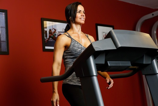 USA, New Jersey, Low Angle Close Up View  of Fit Mid Adult Woman Exercising on Treadmill : Stock Photo