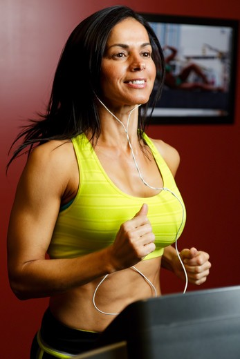 Stock Photo: 1774R-760 USA, New Jersey, Close Up View of Fit  Woman Running  on Treadmill