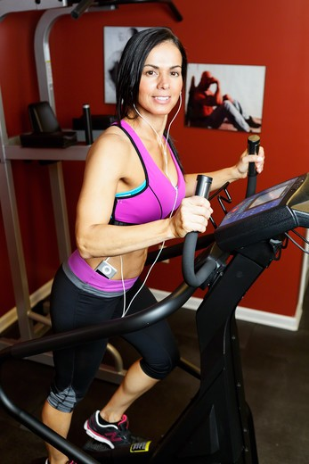 Stock Photo: 1774R-762 USA, New Jersey, High Angle Full Body View of Fit  Woman Exercising on Setpmaster