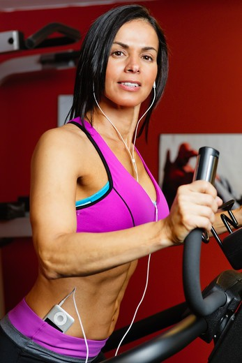 Stock Photo: 1774R-763 USA, New Jersey, Low Angle Close Up  View of Fit  Woman Exercising on Setpmaster