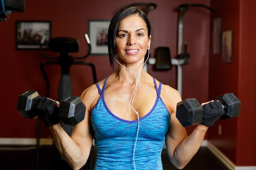USA, New Jersey, Close Up View of  Fit Mid Adult Woman Performing Biceps Curls in Gym : Stock Photo