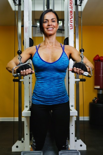 Stock Photo: 1774R-768 USA, New Jersey, Low Angle View of Woman During Gym Weight Training on Pulley Machine