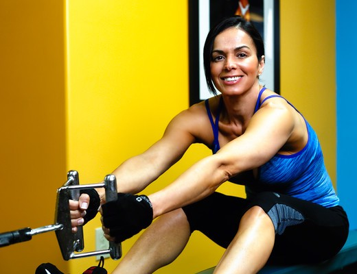 Stock Photo: 1774R-769 USA, New Jersey, Close Up View of Fit Mid Adult Woman Working Out in  Gym on  Exercise Equipment
