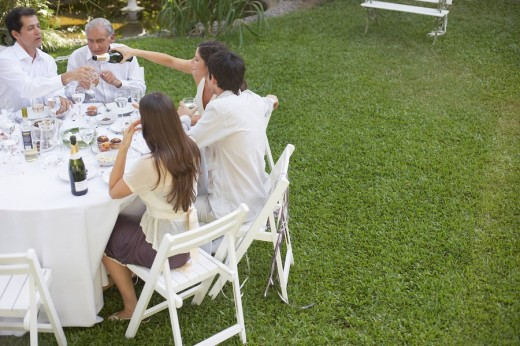 Five people at outdoor party socially drinking : Stock Photo