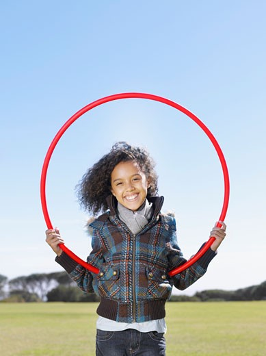 Young girl playing with hula hoop : Stock Photo