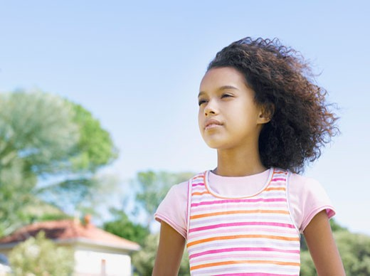 Stock Photo: 1775R-11182 Young girl daydreaming