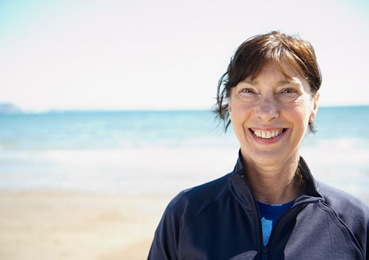 Stock Photo: 1775R-11259 Smiling mature woman on beach