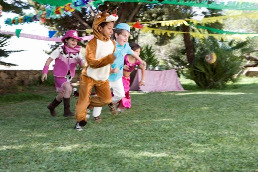 Children playing in costume at birthday party : Stock Photo