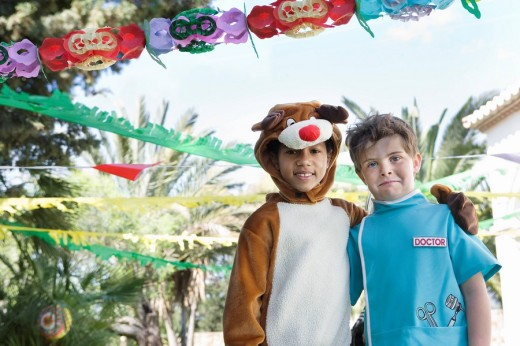 Stock Photo: 1775R-11325 Two boys in cow and doctor costumes at birthday party